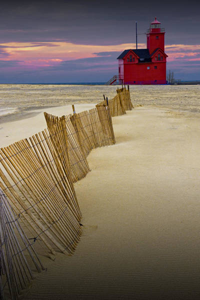 Holland State Park Photograph - Big Red Lighthouse With Sand Fence At Ottawa Beach by Randall Nyhof