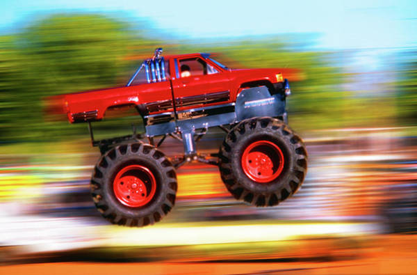 Freestyle Photograph - Big Wheeled Red Truck Jumping Blurred by Vintage Images