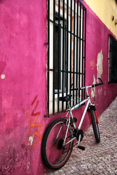 Wall Art - Photograph - Bike In The Pink Alley by John Rizzuto