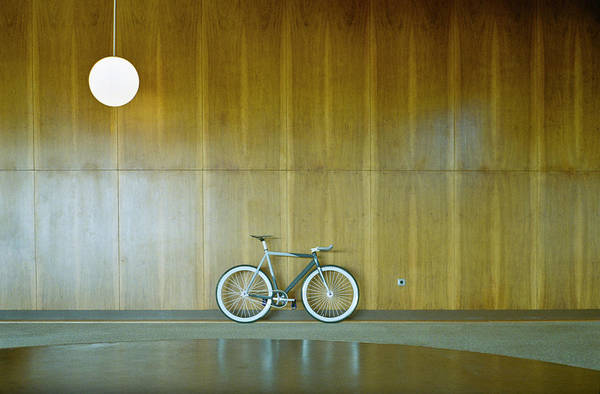 Pendant Photograph - Bike Parked Against Wood Paneling by Dejan