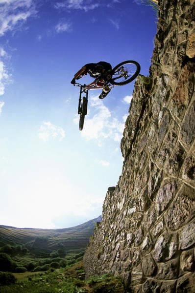 Freestyle Photograph - Biker Making Wall Jump In France by Scott Markewitz