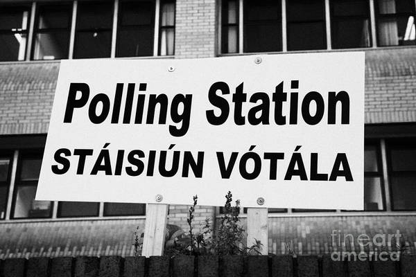 Gaelic Photograph - Bilingual Irish Polling Station Sign Dublin Republic Of Ireland by Joe Fox