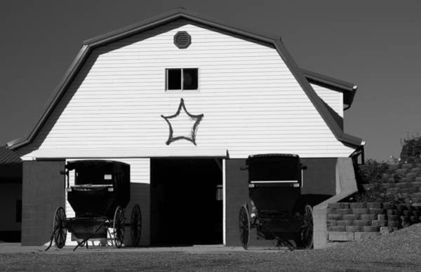 Wall Art - Photograph - Black And White Amish Buggies And Barn by Dan Sproul