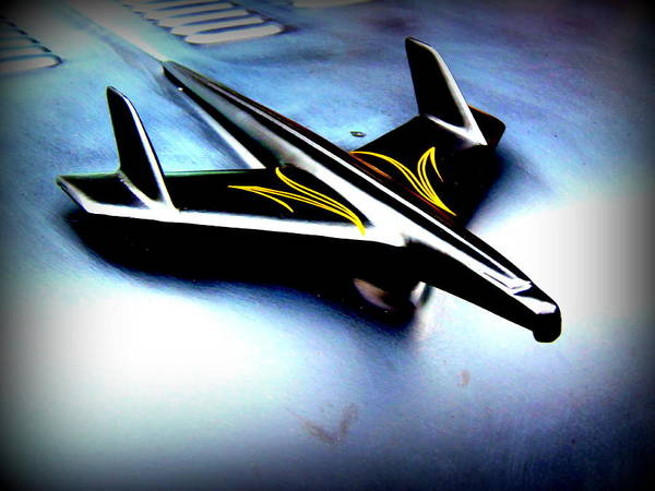Black And Yellow Hood Ornament  Art Print by Willy  Nelson