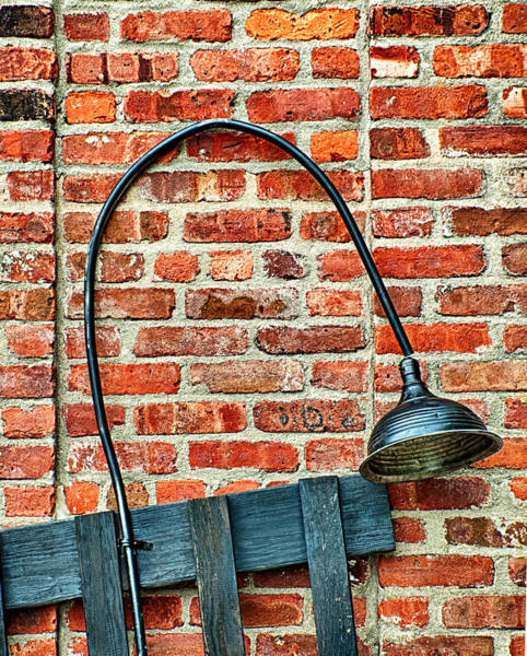 Photograph - Black Lamp Against Brick Wall by Gary Slawsky