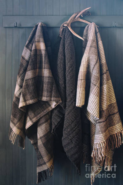 Photograph - Blankets Hanging On Coat Hooks With Antlers by Sandra Cunningham