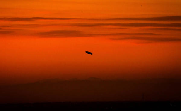 Blimp At Dusk Art Print
