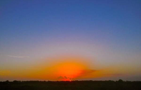 Disappearance Photograph - Blue Sky's Sunset by Joe Wyman