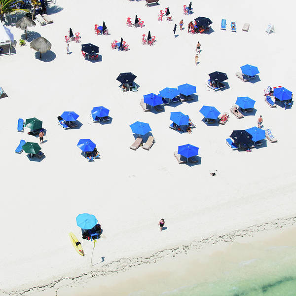 Water Photograph - Blue Umbrellas On A Sunny Beach by Tommy Clarke
