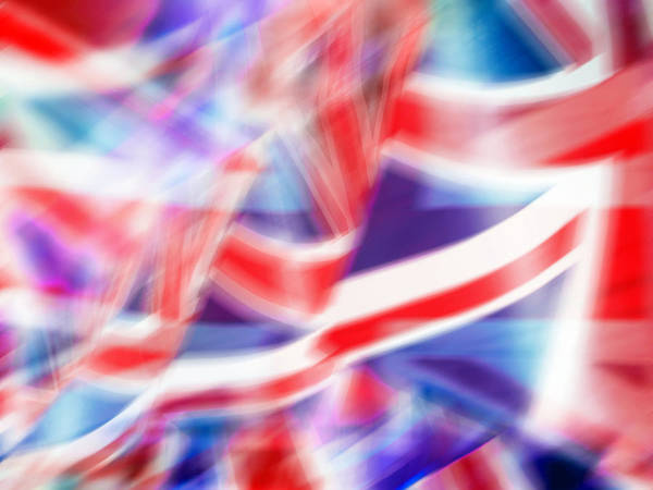 Celebration Photograph - Blurred Motion Image Of British Flags by Doug Armand