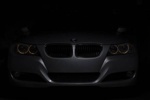 Wall Art - Photograph - Bmw Car In Black Background by Paulo Goncalves