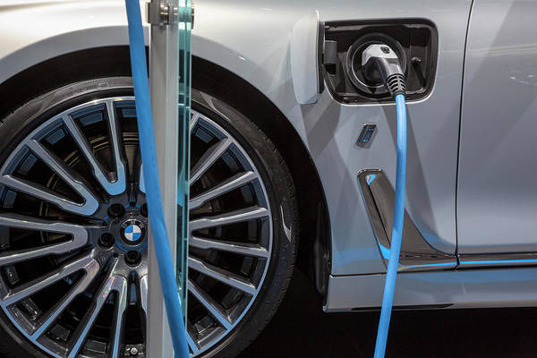 Plug-in Photograph - Bmw Plug-in Hybrid Vehicle Charging by Jim West/science Photo Library