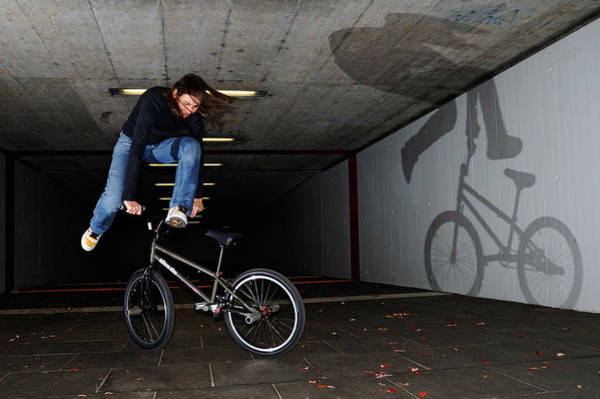 Photograph - Bmx Flatland Monika Hinz Doing Awesome Trick With Her Bike by Matthias Hauser