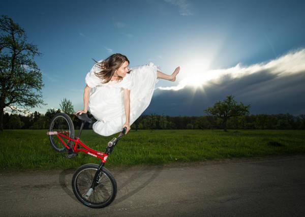 Bmx Photograph - Bmx Flatland Rider Monika Hinz Jumps In Wedding Dress by Matthias Hauser