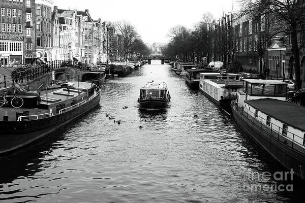 Photograph - Boat Down The Canal by John Rizzuto