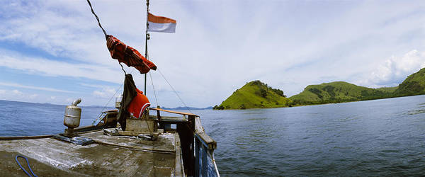 Flores Photograph - Boat In The Sea With Islands by Panoramic Images