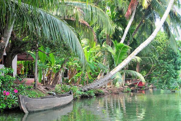 Roxbury Wall Art - Photograph - Boat Lays Along A Kerala Canal by Steve Roxbury
