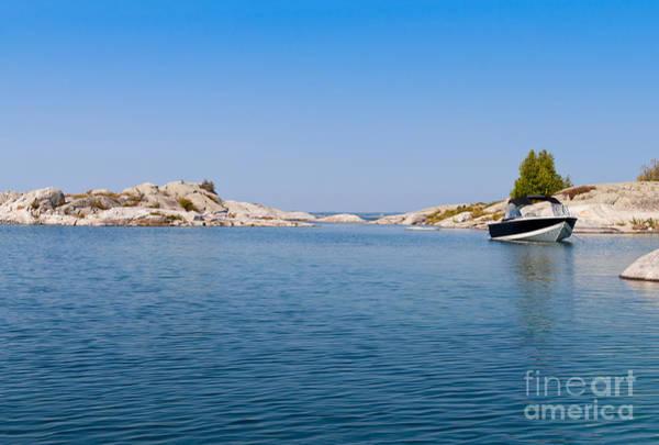 Photograph - Boat On A Blue Lake by Les Palenik