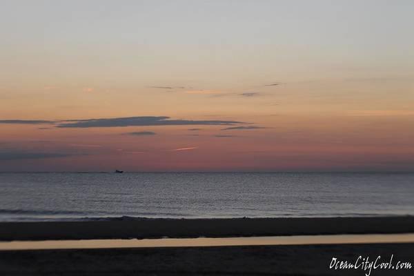 Photograph - Boat On The Horizon At Sunrise by Robert Banach