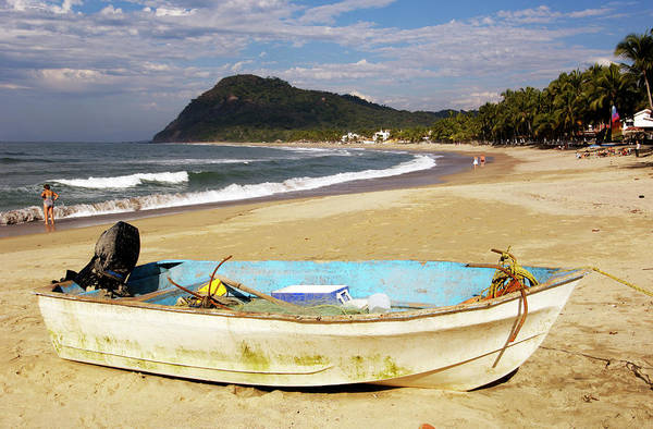 Outboard Engine Photograph - Boat With Outboard Motor On Beach by Dan Gair