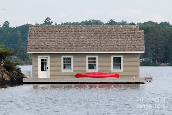 Photograph - Boathouse With A Red Canoe by Les Palenik