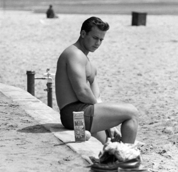 1953 Photograph - Body Builder At The Beach. by Underwood Archives