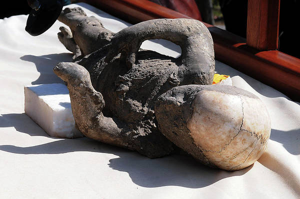 Wall Art - Photograph - Body Cast Of A Child Victim Of Pompeii Eruption by Pasquale Sorrentino/science Photo Library