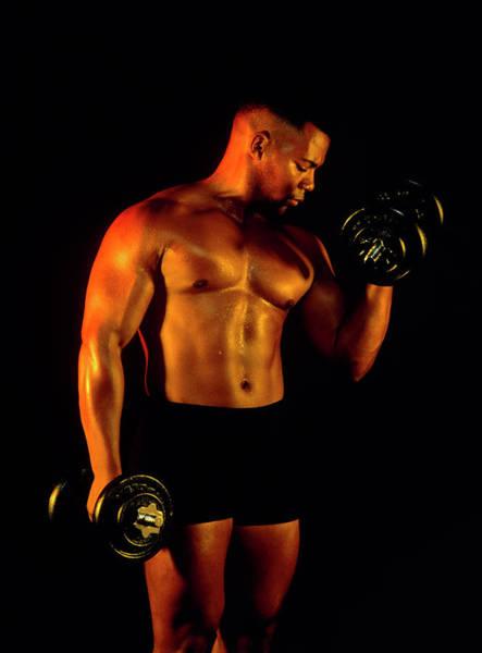 Bodybuilding: Man Using Dumb-bell On His Biceps Art Print