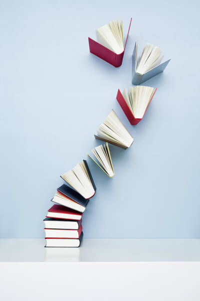 Learning Photograph - Books Taking Off From A Stack by Jorg Greuel