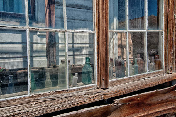 Wall Art - Photograph - Bottles In The Window by Cat Connor