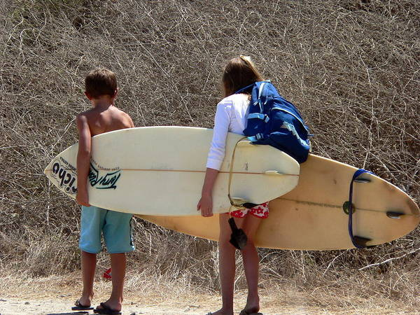 Photograph - Boy And Girl Carrying Surfboards by Jeff Lowe
