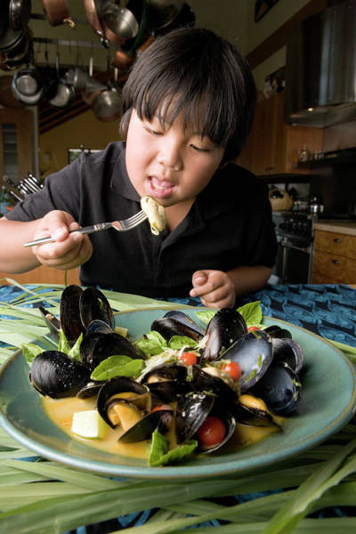 Mussel Wall Art - Photograph - Boy Eating Mussels by Peter Menzel/science Photo Library