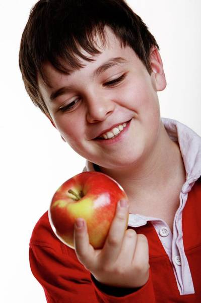 Wall Art - Photograph - Boy Holding An Apple by Mauro Fermariello/science Photo Library