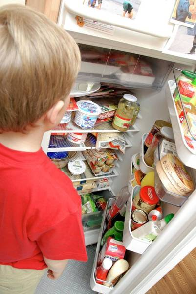 Wall Art - Photograph - Boy Looking In Fridge by Aj Photo/science Photo Library