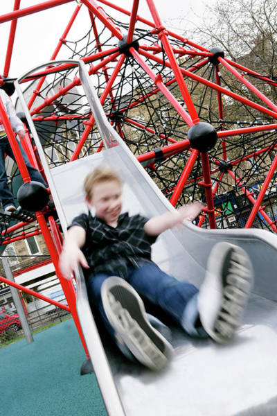 Slide Photograph - Boy On A Slide by Gustoimages/science Photo Library