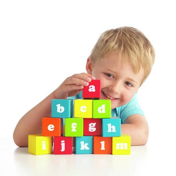 Wall Art - Photograph - Boy Playing With Alphabet Blocks by Science Photo Library