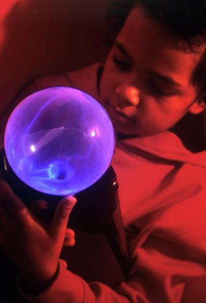 Wall Art - Photograph - Boy Touching A Plasma Globe by David Hay Jones/science Photo Library