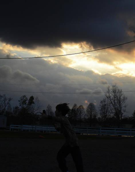 Photograph - Boy Under Dark Skies In New Orleans by Louis Maistros