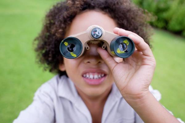 Parks And Recreation Photograph - Boy Using Binoculars by Ian Hooton/science Photo Library