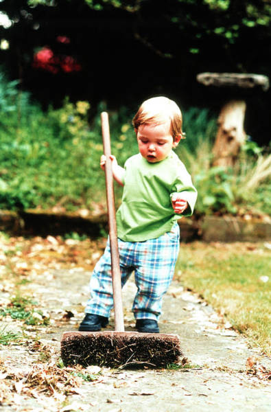 Infant Photograph - Boy Using Broom by Sue Prideaux/science Photo Library