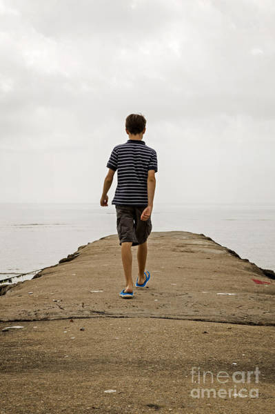 Photograph - Boy Walking On Concrete Beach Pier by Edward Fielding