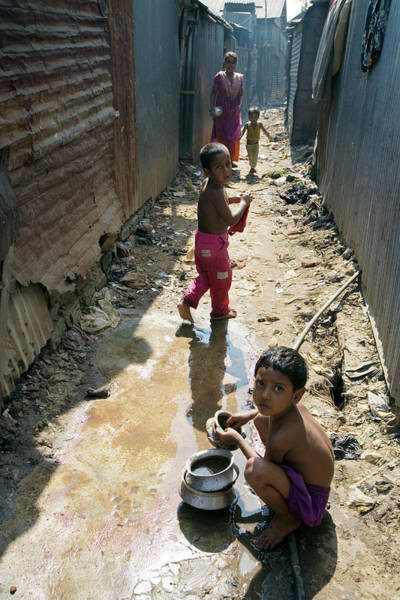 Mud House Photograph - Boy Washing Dishes In Dirty Water by Adam Hart-davis/science Photo Library