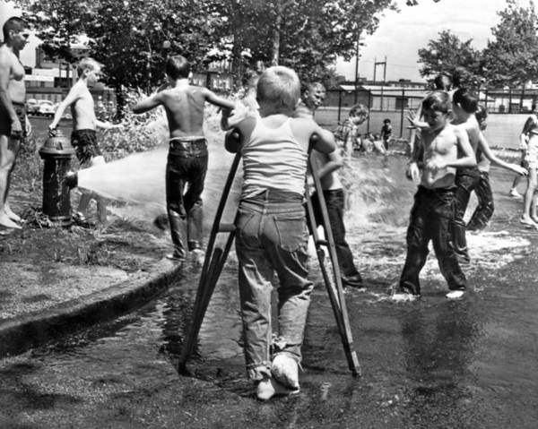 Water Hydrant Photograph - Boy With Broken Leg by Underwood Archives