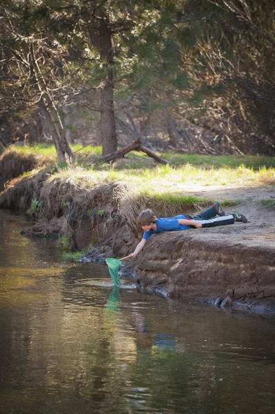 Casual Photograph - Boy With Net Playing In A Stream by Stephen Simpson