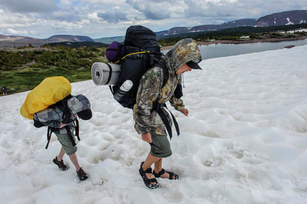 Uinta Photograph - Boys Cross A Snowfield Above Five Point by Beth Wald