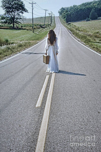 Wall Art - Photograph - Bride Walking With Suitcase On Country Road by Jill Battaglia