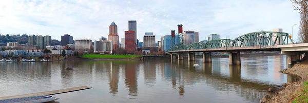 Willamette Photograph - Bridge Across A River With City Skyline by Panoramic Images