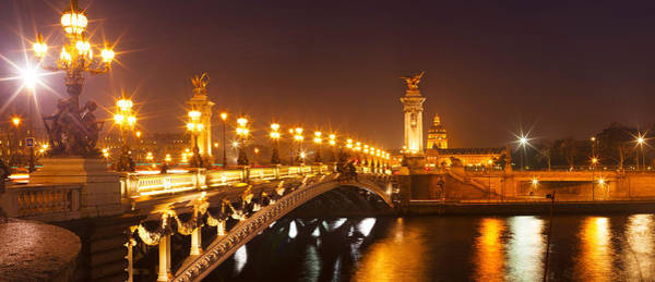 Alexandre Photograph - Bridge Across The River At Night, Pont by Panoramic Images