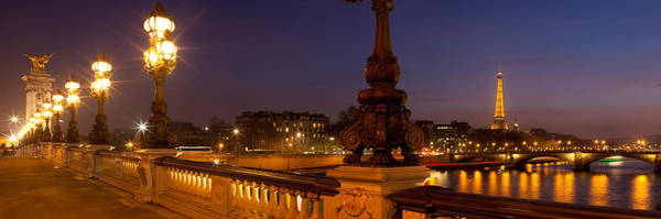 Alexandre Photograph - Bridge Across The River Lit Up At Dusk by Panoramic Images