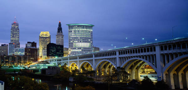 Suspended Photograph - Bridge In A City Lit Up At Dusk by Panoramic Images